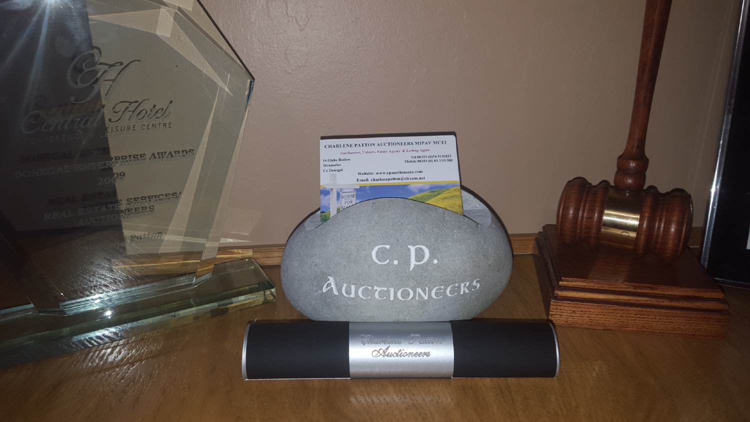 CP Auctioneers stone and gavel